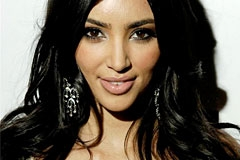 Kim Kardashian Gets Semi-Nude for 2010 Calendar